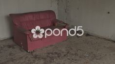 Abandoned Damaged Sofa Couch Chair Left In Derelict Building Hand Held - Stock Footage | by RyanJonesFilms
