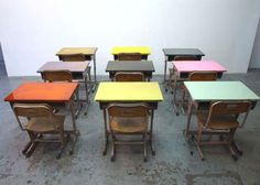 I like these old school desks with a painted top. I sat at one of these in my school days, but not with these cool tops.