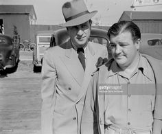 A vintage press shot of comic legends Bud Abbott and Lou Costello arriving on the Universal back lot in Los Angeles CA, circa 1942!