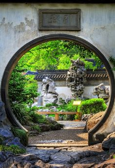 Yuyuan Gardens - these entrances are known as 'Moon Gates' and are so shaped to only allow one person in at a time, to allow them to appreciate the garden's beauty.