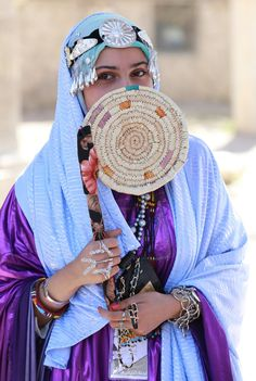 """TRIPOLI, LIBYA - MARCH 13: A Libyan woman wearing traditional clothes attends an event to mark the """"National Day of Traditional Dress"""" at es-Suheda Square in Tripoli, Libya on March 13, 2017. ( Hazem Turkia - Anadolu Agency )"""
