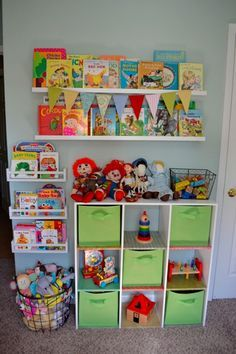 Small Space Organization Toy Wall perfect for our joint toy room/ library. |