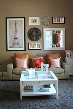 Living Room Wall Collage done well. Simple mix of large, small, round, rectangle, square, color and black & white.