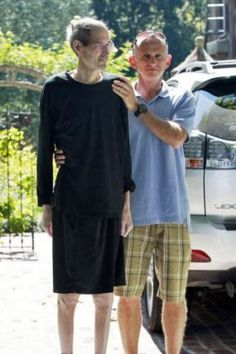A frail Steve Jobs is helped into a car by a friend outside his home in California on August 26, 2011.