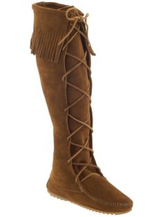 Minnetonka.  I've got these, but mine are a lighter color.  I love them and wear them all the time when the weather is cool!