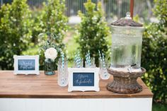 Hampton Event Hire // White VJ Timber Bar / Wicker Drink Dispenser / Decorative Water Glasses / Ornate White Photo Frame // Servicing Byron Bay / Gold Coast / Brisbane