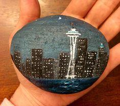 #rockpainting #theemeraldcity #acrylicrockpainting #seattleskyline