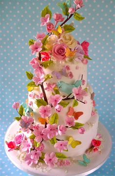 Birds and Blossoms A Spring wedding cake with a bird and blossom theme. Lynette, UK, www.niceicing.com