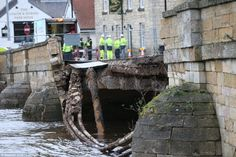 Gone: The300-year-old bridge in Tadcaster, North Yorkshire, collapsed as a result of the floods which have devastated communities across the north. It comes as residents are being warned to expect further flooding as Storm Frank sweeps in across Britain today