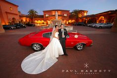 Classic red 68  in front of the classic Grand Del Mar in San Diego. Luxury Wedding Photography by photographer Paul Barnett.