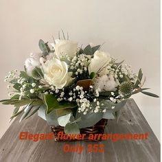 Elegant flower arrangement in white  35$ pickup only #annespetals #toowoombaflorist #toowoombaflowers #toowoombasmallbusiness #flowersofinstagram #toowoombaregion #toowoomba #toowoombaliving #toowoombalife #toowoombaweddingflorist #toowoombalocal #toowoombahandmade Flower Arrangement, Floral Wreath, Wreaths, Table Decorations, Elegant, Furniture, Home Decor, Classy, Floral Arrangements