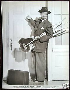 Two birds with one stone! Red Skelton plays the Fuller Brush man.