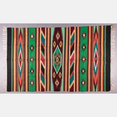 Lot 429 A NAVAJO WOVEN RUG Est: $800 - $1,200 Description A Navajo Woven Rug, Mid-20th Century, Comprising of twelve colors in a banded diamond pattern. Dimensions: 7 ft. x 4 ft. 3 in.