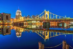 The Roberto Clemente Bridge reflects in the calm waters of the Allegheny River in Pittsburgh HDR