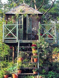 a tree house in the garden ...