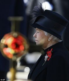 11,11,11. Britain's Queen Elizabeth II. Amazing photo - her expression says it all. Lest we forget. (11/11/2012)