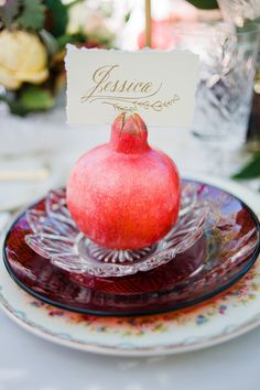 This pomegranate name card holder feels so very holiday! Put one of these at each place setting, add some vintage-inspired rentals, and top with a calligraphed card. The resulting table will feel as if you've set the scene for an intimate family dinner party.