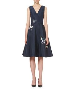 Carolina Herrera faille cocktail dress with butterfly appliqu. V neckline. Sleeveless. Fit-and-flare silhouette. Hidden back zip. Polyester/cotton/nylon. Acetate/polyester lining. Made in USA of Itali