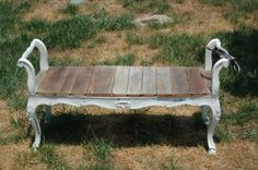 an old bench frame, sanded barn wood for a seat - use as a bench or coffee table!  yes, please!
