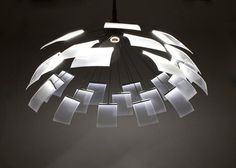"""Denise Hachinger's Kronleuchter """"crown light"""" undergoes a mechanical metamorphosis from a closed, static form, to an open and dynamic one."""