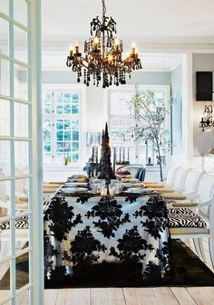Wow, the chandelier, rug and tablecloth, zebra seats mixed with damask...