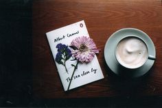Words and cappuccino (and flower).