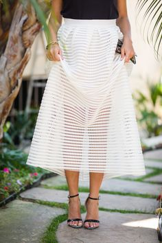 Full midi skirts are everyone's friend because they give you that hourglass shape and they are the ultimate feminine must-have for summer.