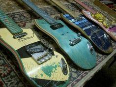 Skateboard turned into Electric Guitars