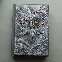 Handcrafted Fairytale Book Covers  Aniko Kolesnikova, known as Mandarin Duck, is a jewelry designer who also sculpts fairytale book covers with polymer clay. In this way, she gives life to creatures such as dragons, owls and elephants with a great sense of aesthetics.