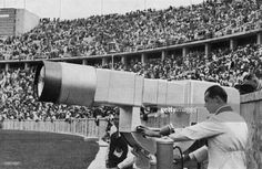 A German technician checks the Television canon put in the Olympic Stadium, Aug. The huge electronic camera build by Telefunken broadcast live for the first time, 8 hours each day, the Berlin Olympics Games show. 1936 Olympics, Berlin Olympics, Summer Olympics, Leni Riefenstahl, Olympic Committee, University Of Washington, Screwed Up, Olympic Games, Cool Pictures
