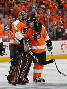 APRIL 29: Danny Briere #48 of the Philadelphia Flyers celebrates his overtime goal against the New Jersey Devils with teammate Ilya Bryzgalov #30 in Game One of the Eastern Conference Semifinals during the 2012 NHL Stanley Cup Playoffs at the Wells Fargo Center on April 29, 2012 in Philadelphia, Pennsylvania. (Photo by Jim McIsaac/Getty Images)