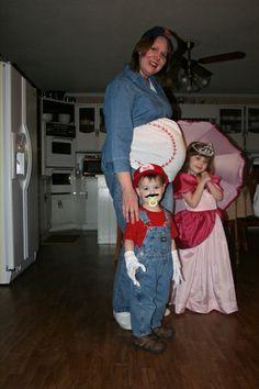 Cute baseball costume for a pregnant lady. (Mario & Princess Peach also pictured)