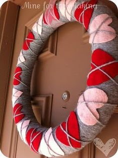 Cute Valentines Day wreath. I absolutely LOVE this wreath. Its sooo cute and super easy to make. You could easily change up the yarn color & hearts for any holiday. Halloween could be black, purple, or orange yarn with pumpkins, spiders, witches, witch hats etc.