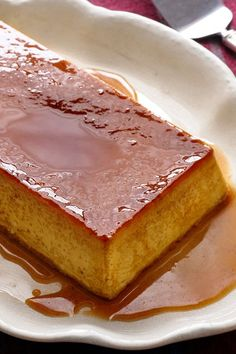"""NYT Cooking: This traditional Iberian flan, is now sometimes called """"Flan a la Antigua,"""" or Flan of the Past. That's because it doesn't include the common New World ingredients of condensed and evaporated milk. Instead, it is pure poetry made of eggs, sugar and milk. It does call for modern technology — blender and microwave — to streamline the preparation. The edge of sharp caramel%..."""