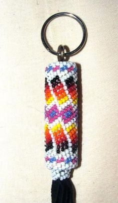 """Beaded Keyring Native American Made Peyote Stitch on Black leather 8"""" CE-7 Peyote stitch style beadwork around a leather wrapped wooden dowel.  Native American made.  New.  One of a kind!  #beadwork #nativeamerican #keychain by Ti@n@h"""