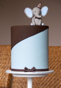 Wedding cake - only with two elephants one wearing a dress, the other with a tuxedo
