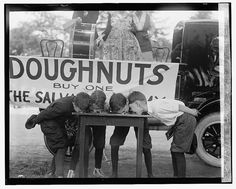 Doughnut eating contest. Photo by National Photo Company Collection, 1922 May 20. http://hdl.loc.gov/loc.pnp/npcc.06242