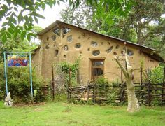 cob houses pictures | cob house with leaf-formed window | For the Home