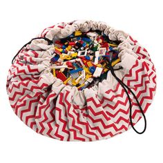 A simple and effective toy storage solution, this two-in-one play mat & storage bag makes it simple to gather toys up in one easy motion.Red Zig Zag Other colours available<ul> <li>Undercover loves this !</li> <li>Who wants to clear up lego? Not us</li> <li>So easy to us....just draw up the cords</li> <li>Two-in-one play mat & toy storage bag</li> <li>Portable, hardwearing design</li> <li>Perfect for the gargen, holidays, trips to the park or picnics on the beach</li> <li>Makes a ter...