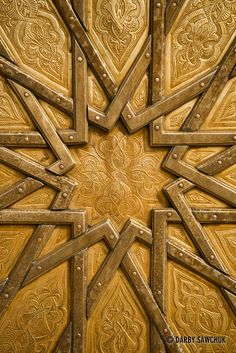 A close up view of the detailed metalwork on one of the doors to the Royal Palace in Fes, Morocco.