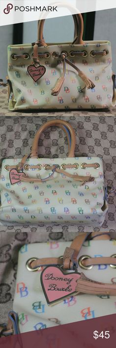 Dooney & Bourke Purse Authentic Small Size Dooney & Bourke Purse. Cream Colored with multi-colored DB all over. This item has been used and has a small amount of discoloration at the bottom. Dooney & Bourke Bags Mini Bags