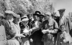 Tabriz, Iran. A Red Army political instructor hands out propaganda leaflets to Tabriz residents during the Anglo-Soviet Invasion of Iran in World War II. Vasily Yegorov/TASS - pin by Paolo Marzioli