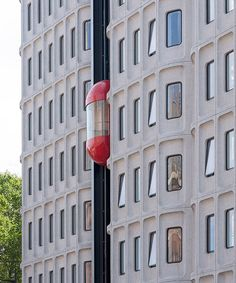 with the standard hotel conversion in london, orms retain the original brutalist concrete structure with its distinct rounded windows. Precast Concrete Panels, Concrete Structure, Archi Design, Gym Design, Brutalist Buildings, Architectural Styles, London Hotels, Architecture Details