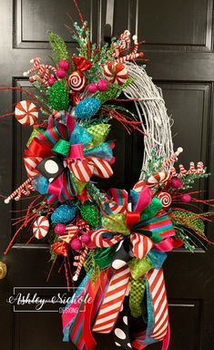This Candyland Christmas wreath will be a great addition to your home. It looks beautiful on a front door or a back door and the children will just adore it. This wreath is constructed on a 24 Oval White Grapevine Candy Christmas Decorations, Fall Door Decorations, Christmas Swags, Christmas Centerpieces, Holiday Wreaths, Rustic Christmas, Christmas Crafts, Winter Wreaths, Whimsical Christmas