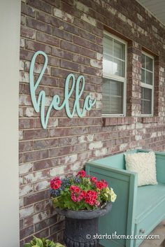 We love this hello welcome sign to add a pop of colour on the house!