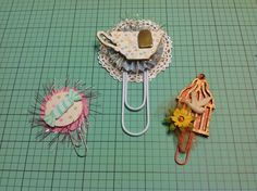 Altered paper clips for a wand and paper clip swap