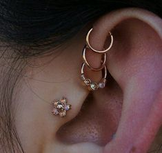 These hoops look so good #traguspiercing #fronthelixpiercing #triplefronthelix #conchpiercing #earpiercing #multiplepiercings #piercings #pierced #piercer #bodyjwellery #bodymods #girlswithpiercings #guyswithpiercings #goals #piercinggoals #badass