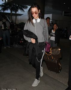 Jet-lagged? Bella Hadid appeared a trifle weary as she landed at LAX on Thursday following a girls' night out with sister Gigi in Paris on Wednesday