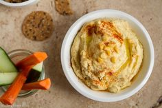 Sunshine Spread from ohsheglows Yield: around 2 cups      3/4 cup uncooked yellow split peas     1 large garlic clove     3 tbsp tahini     4-5 tbsp fresh lemon juice, to taste     1/2 cup water, or as much as needed to thin out     2 tsp extra virgin olive oil     3/4 tsp fine grain sea salt (or to taste)     1 tsp white vinegar (optional)