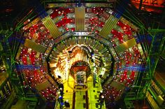 These photos show the world's largest particle accelerator, the Large Hadron Collider, at the CERN physics lab in Geneva, Switzerland. Boson De Higgs, Particle Collider, Cern Collider, Structure Of Matter, Super Collider, Cosmos, Elementary Particle, Particle Accelerator, Large Hadron Collider